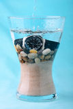 Scuba watch in a vase with sand and pebbles Royalty Free Stock Image