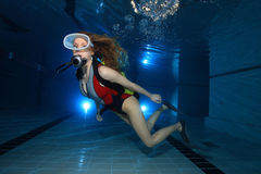 Scuba woman. Female scuba diver in the pool royalty free stock image