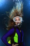 Scuba woman. With long hair underwater royalty free stock photography