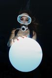 Scuba woman with sphere underwater Stock Photos