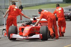 Scuderia Ferrari. Racing team getting classic F1 car ready to compete Royalty Free Stock Photos