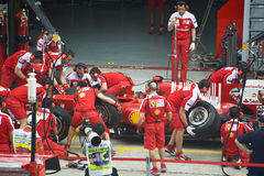 Scuderia Ferrari Marlboro Formula One Racing Team. The crew of Scuderia Ferrari Marlboro F1 racing team practicing tyres change during Petronas Malaysian Grand Stock Images
