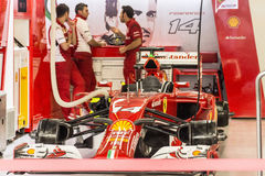 The Scuderia Ferrari Team. Mechanics prepare the car of Fernando. Sochi, Russia -9 November 2014 : Formula One, Russian Grand Prix, Sochi autodrom , 16 stage Royalty Free Stock Photos