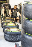 Scuderia Toro Rosso. Mechanics. Preparation of rubber for racing. Sochi, Russia -9 November 2014 : Formula One, Russian Grand Prix,  Sochi autodrom , 16 stage Royalty Free Stock Image