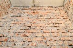 Scuffed кирпичная стена Стоковые Фото