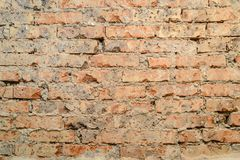Scuffed brick wall Stock Images