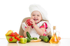 Scullionkid with vegetables isolated on white Stock Images