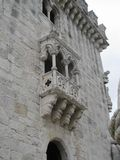 Sculpted balcony on stone building