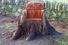 Sculpted chair from a tree trunk Royalty Free Stock Photos