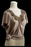 Sculpted flower neckline blouse knotted waist Stock Photography