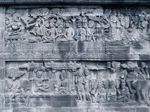 Sculpted relief stone from Borobudur Temple Royalty Free Stock Photos