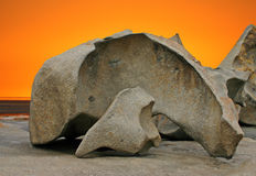 Sculpted rock formation and orange sky Royalty Free Stock Photo