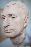 Sculpted sculpture of a male head, bust. Vertical frame. Sculpted sculpture of a male head, bust Royalty Free Stock Images
