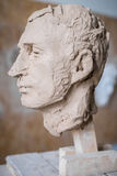 Sculpted sculpture of a male head, bust. Vertical frame stock photography