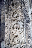 Sculpted stone depicting a dinosaur at the ancient Ta Prohm temple at Angkor Wat. Stock Photo