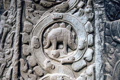 Sculpted stone depicting a dinosaur at the ancient Ta Prohm temple at Angkor Wat. Royalty Free Stock Photography