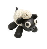 Sculpter mignon d'argile de moutons Photo stock
