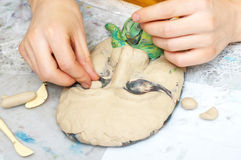 Sculpting craft. With plasticine the form of face with moustache Royalty Free Stock Photo