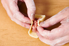 Sculpting of meat dumplings Stock Photos