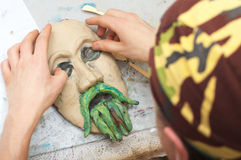 Sculpting plasticine face Stock Images