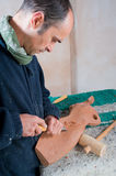 Sculptor. Working on his art at his workshop Royalty Free Stock Image