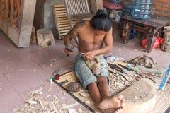 Sculptor bali. Sculptor wood carver bali indonesia Royalty Free Stock Photos