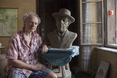 Sculptor Boris Leiner with his bust of Dylan Stock Image