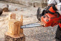 The sculptor carves the wood with the chainsaw. During a public demonstration Stock Image