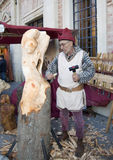 Sculptor carving a sculpture of a woman in a woode Stock Photo