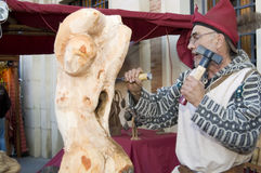 Sculptor carving a sculpture of a woman in a woode Royalty Free Stock Photo