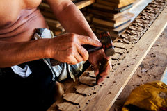 Sculptor is carving wood Stock Photo
