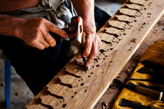 Sculptor is carving wood Royalty Free Stock Photo