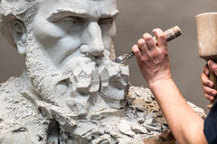 Sculptor carving. Stock Image