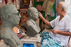 Sculptor creating clay statues Royalty Free Stock Images