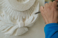 sculptor cuts model statue, hand detail Royalty Free Stock Photo