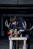 Sculptor handles elk skull in dark Royalty Free Stock Photo