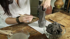 Sculptor hands working close-up stock video footage