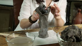 Sculptor Hands Working. Sculptor woman sculpts from raw clay close-up stock video