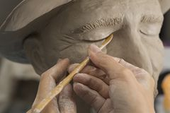 Sculptor making art from the mud. Art royalty free stock photo