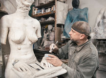 Sculptor man working in his workshop Royalty Free Stock Images