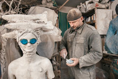 Sculptor man working in his workshop Stock Photo