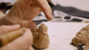 Sculptor is modeling clay figurine or statuette stock video footage