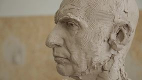 Sculptor modelling sculpture adjusting face details head made of clay. Creative concept stock video footage