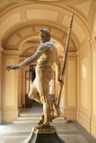 Sculptor of Neptune, god of the sea. Sculptor of Neptune,god of the seas in Roman mythology, holding his spear, in a museum in Italy Royalty Free Stock Photos