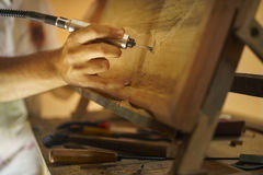 Sculptor Painter Artist Chiseling A Wooden Bas Relief-2 Royalty Free Stock Photos