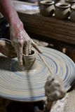 Sculptor and pottery. Royalty Free Stock Image