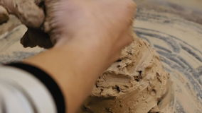 Sculptor is pugging clay for creating pottery stock footage