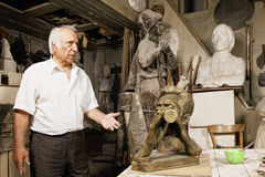 Sculptor showing his works Stock Images