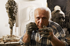 Sculptor in studio Stock Photo
