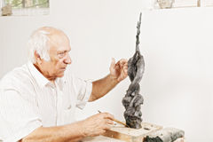 Sculptor tells about his sculpture Royalty Free Stock Photography